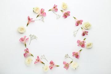Alstroemeria, rose and gypsophila flowers on white background