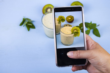Woman takes a picture of food