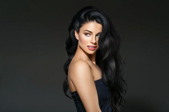 Black hair woman. Beautiful brunette hairstyle fashion portrait over dark background