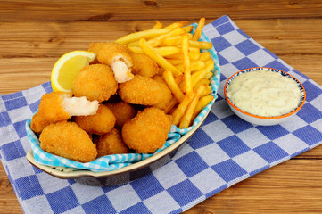 Poster Buffet, Bar Scampi and French fries meal with tartar sauce on a wooden background