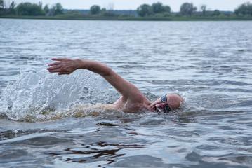 Elderly man swims