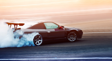 Sport car wheel drifting. Blurred of image diffusion race drift car with lots of smoke from burning tires on speed track. Sport concept,Drifting car concept