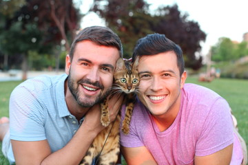 Cute gay couple with a bengal cat