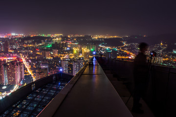 Young people in the city tower overlooking the gorgeous lighting night