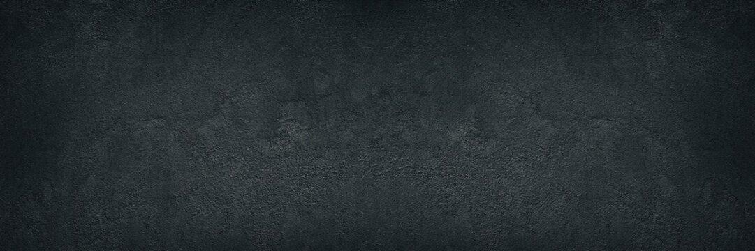 Black rough concrete wall wide texture - dark grunge background