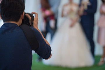 wedding photographer in action.