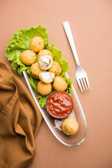 Dahi Ke Angare also known as Kabab or kebab is a popular snack item from India / Pakistan. served with green and red sauce. Selective focus