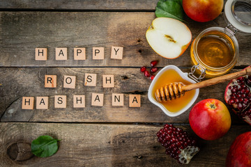 Rosh hashana jewish holiday concept - apples, honey, pomegranate