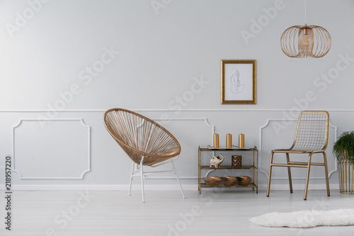 Gold chairs standing in real photo of light grey room interior with on options for inside cabin walls, wallpaper walls, pantry walls, fabric on walls, carpet walls, painting bathroom walls, lumber walls, moulding walls, millwork walls, tiling corners on walls, paint for shower walls, paneling walls, columns for interior walls, bathroom wall decor for walls, decorative molding ideas for walls, plumbing walls, diy board and batten walls, diamond plate vinyl for walls, drywall walls, diy wood plank walls,