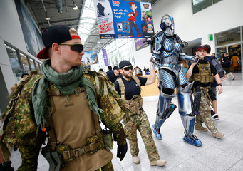 Cosplayers are seen during the media day of the world's largest computer games fair Gamescom in Cologne