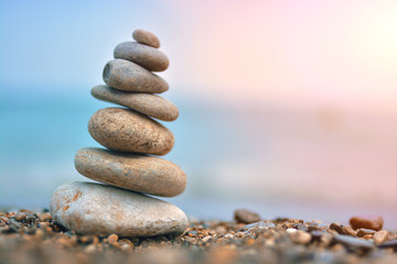 Relaxing on the beach, stack of stones.