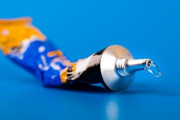 super glue tube on blue background