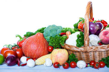 Fresh vegetables and fruits in a basket.