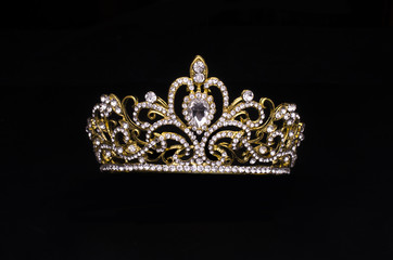 Wall Mural - gold crown with diamonds isolated on black