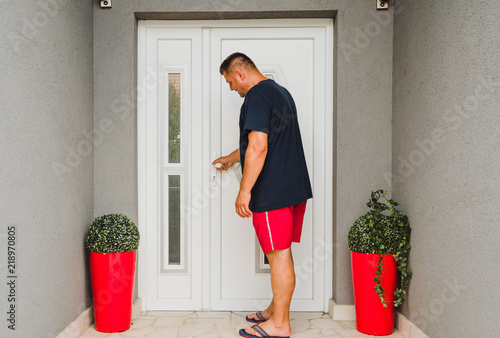Front Door Man Holds Doorknob On Front Door Pvc Stock Photo And