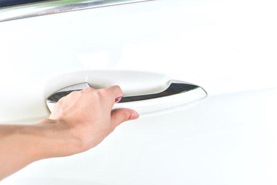 Hand Holding a Car Keyless Door Handle