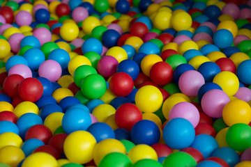 A games room, a box filled with small colored balls, playing in ball land, ball land pattern wallpaper