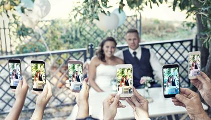 Brautpaar wird fotografiert