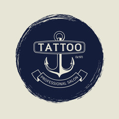 Vintage tattoo salon emblem with anchor vector illustration