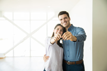 Loving Partners Showing Keys Of New House
