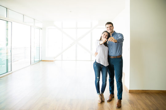 Couple Feeling Happy About Buying New House