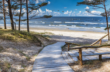 Scenic view  and resting wooden spot near a sandy beach of the Baltic Sea