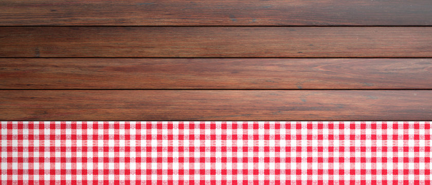 Red white checkered picnic tablecloth on wooden table, banner, copy space. 3d illustration