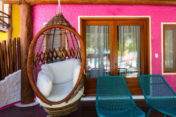 Hanging chair inside a stylish Mexican Villa