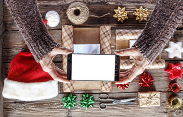Christmas presents , Woman takes with asmartphone, instagrams
