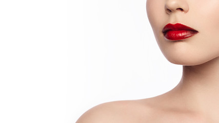 Close-up of a woman's lips with a fashionable make-up in the style of ombre and red lipstick. Long neck and clean skin. Cosmetology, injections, cosmetics, make-up courses, lip augmentation