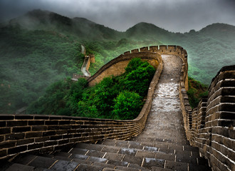 Tuinposter Chinese Muur The Great Wall Badaling section with clouds and mist, Beijing, China