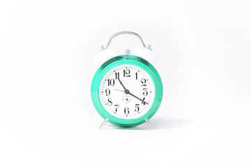 green clock isolated on white studio background.