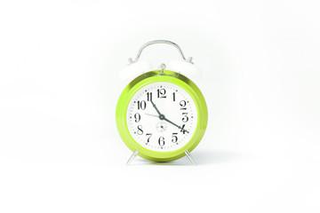 light green clock isolated on white studio background.