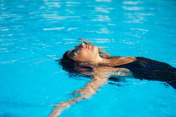 Beautiful woman in the pool