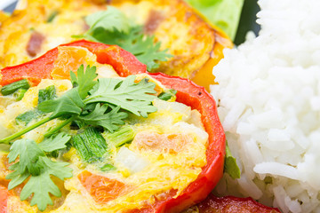 Scrambled eggs fried in the ring of sweet pepper.
