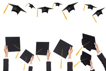 Graduation holds a black hat and a yellow tassel on white isolated background.