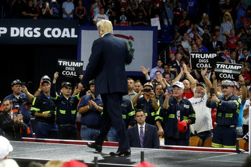 U.S. President Donald Trump acknowledges coal miners during a Make America Great Again rally at the Civic Center in Charleston
