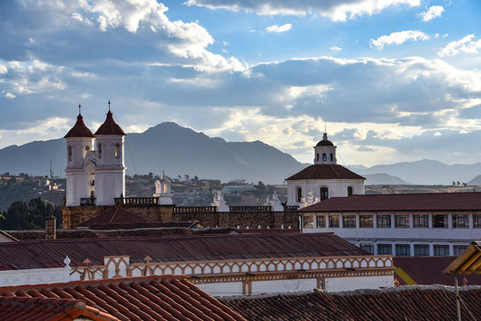 Sunset views over the rooftops of Sucre from the Parador Santa Maria la Real, Sucre, Bolivia