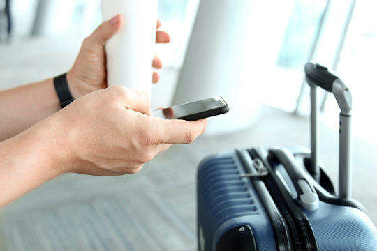 Passengers waiting at the airport/ Passenger using mobile phone and drink coffee