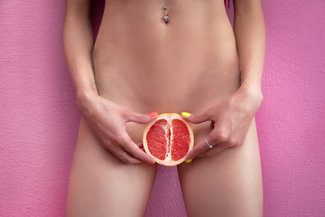 Womens secrets. Girl with grapefruit. Sex concept.