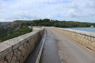 Road on the Marathon Dam on lake Marathon near Athens, Greece