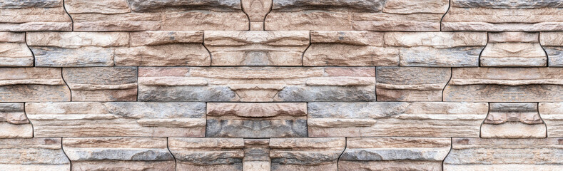 Panorama of Brown stone wall background and texture