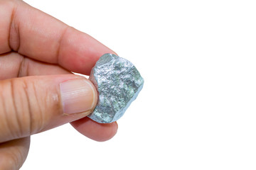 hand holding a silver nugget isolated on white background with clipping path