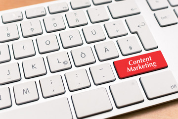 Content Marketing written on red button of computer laptop keyboard