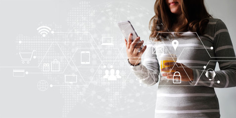 Woman using mobile payments for online shopping and icon customer network connection. Digital marketing, m-banking and omni channel.