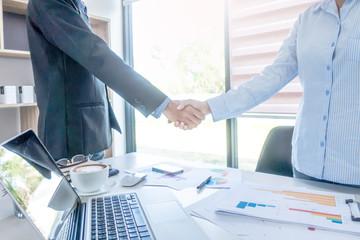 Businessman shaking hands after meeting over business office desk