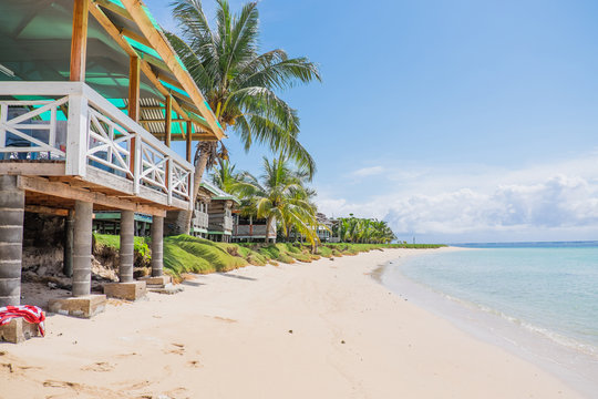 Manase Beach, Savai'i, Samoa, South Pacific - fale tourist accommodation next to sand and blue sea