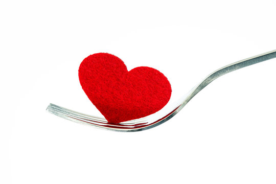 the red heart shape in silver fork , romance love dinning or health heart care concept