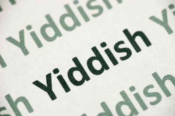 word Yiddish language printed on paper macro