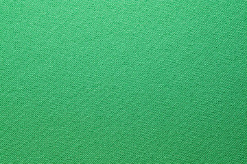 green textile background.Fabric surface